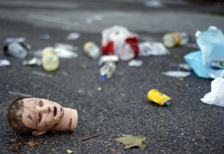 Some of the trash left behind by partygoers outside the Halloween venue, Madrid Arena.