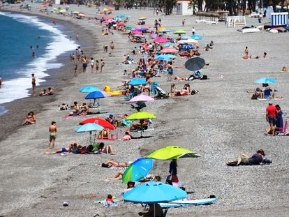 Beachgoers in Almuñécar, Andalusia on Saturday.