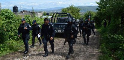 Police officers searching for the students who went missing in Iguala.