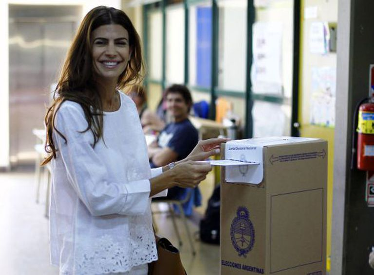 Macri's wife, Juliana Awada, casts her vote on Sunday.