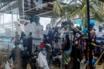 Migrants wait in Necoclí dock. The 2018 earthquake in Haiti forced many people to leave the country.