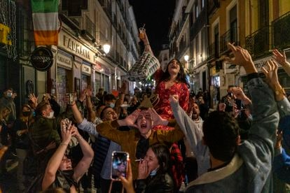 Dozens of people in the center of Madrid in Friday after leaving bars at 11pm, the starting time for the region's curfew.