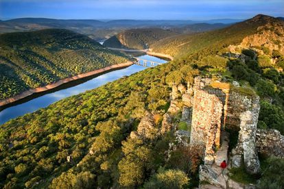 At this extraordinary, 18,000-hectare Mediterranean forest, one can enjoy stunning groves of trees and the sight of birds, including Spanish Imperial Eagles that are indigenous to the area. At the center of the park stands a tower, a ruin from the old castle of Monfrague (pictured). There, you can get the best view of the landscape.