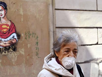 A woman wears a face mask in Rome during the coronavirus crisis.