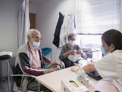 A nurse treats Manuel Fernández, 90, at the Besòs primary healthcare center in Barcelona.