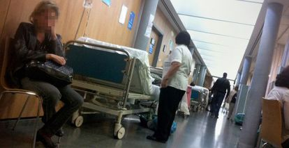 Patients lie in the corridor of an emergency ward at a Madrid hospital.