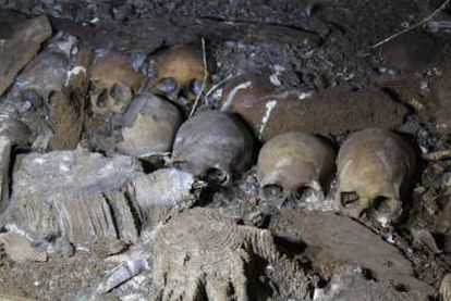 Skulls heaped within the Biniadrís cave in Menorca.