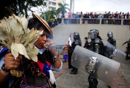 An indigenous Colombian performing a ritual during a protest in Cali on April 28.