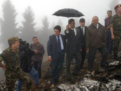 Former Spanish Defense Minister Federico Trillo (in blue jacket) at the site of the accident in 2003.