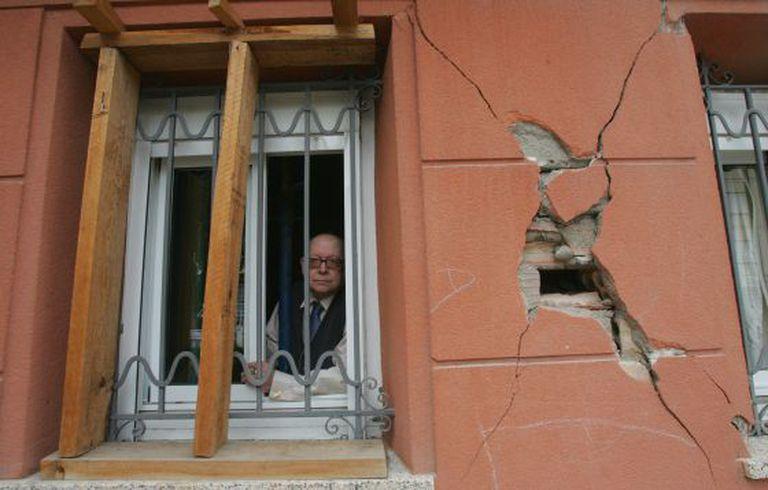 Jesús Pérez, 76, looks out the window of his Lorca home.
