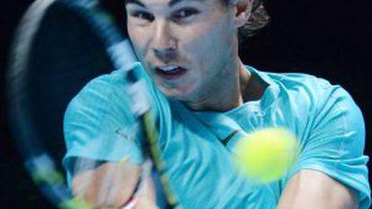 Rafael Nadal returns to Switzerland's Roger Federer during their World Tour Finals semifinal match.