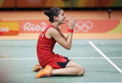 Carolina Marín celebrates her gold medal in badminton.