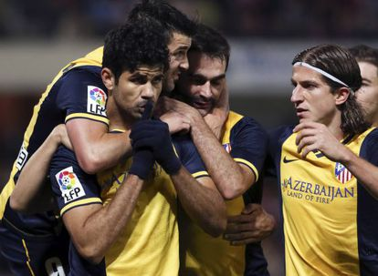 Athlético de Madrid striker Diego Costa is congratulated by his teammates after scoring a goal.