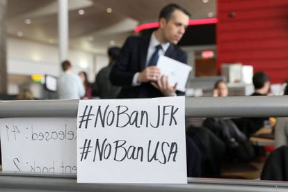 Signs against the travel ban at JFK airport in New York.