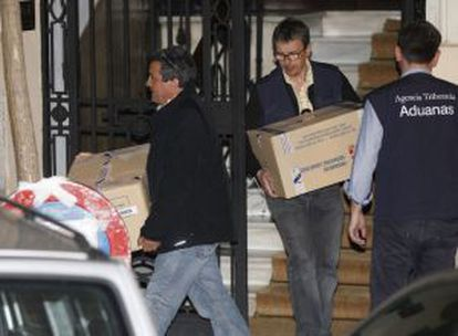 Investigators took away several boxes filled with evidence from Rato's home.
