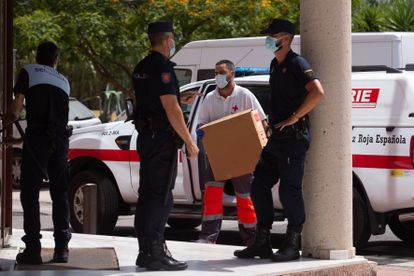 A member of the Red Cross brings medical supplies to an emergency center in Málaga, where a coronavirus outbreak has been detected.