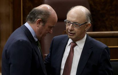 Luis de Guindos and Cristóbal Montoro, economy and finance ministers.