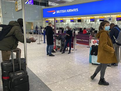 UK travelers returning to their homes in Spain wait to speak to airline staff after being refused boarding at London's Heathrow airport on January 2.