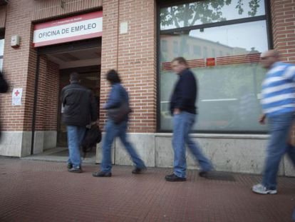 People entering an employment office in Madrid.