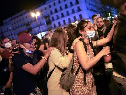 Hundreds of people gather in Puerta del Sol square in Madrid to celebrate the end of the state of alarm.