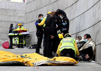 The emergency services aiding people injured in today's blast in Madrid.