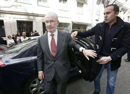 Former deputy prime minister Rodrigo Rato arrives at his office.