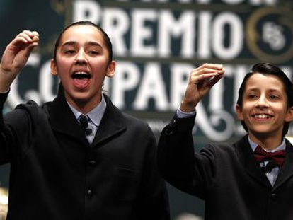 Two students from San Ildefonso school singing out numbers at the 2014 Christmas lottery draw.