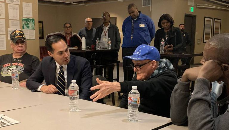 Castro (2nd l) at a panel discussion with homeless veterans in Los Angeles.