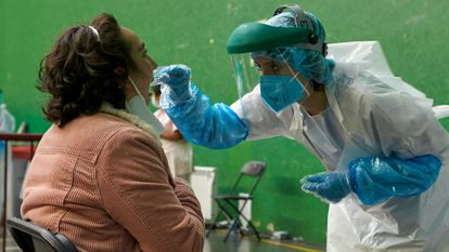 A health worker performs a PCR test in Spain's Basque Country.