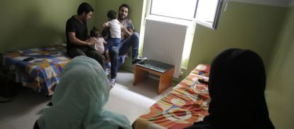 Syrian refugees staying at a Madrid hotel, but hoping to move on to Germany.