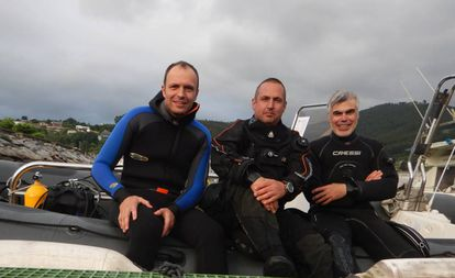 The three divers who discovered the remains of the submarine.