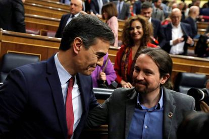 Pedro Sánchez (l) and Pablo Iglesias will lead a coalition government after securing parliamentary endorsement on Tuesday.