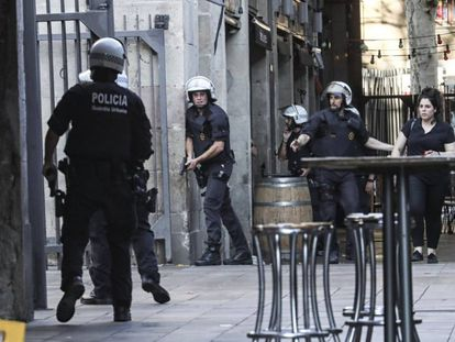 Police clear central Barcelona on Thursday afternoon.