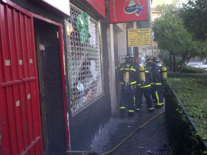 Firefighters at the scene after the explosion in the store known locally as Cañamán.
