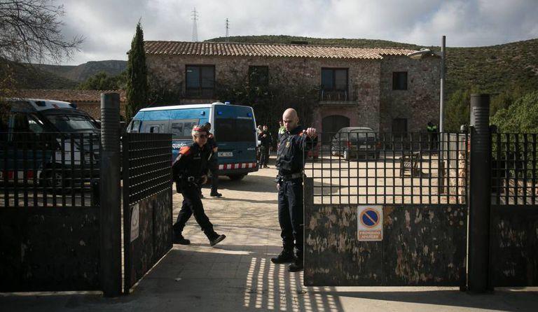 Police guarding the Cal Ganxo center in Castelldefels.