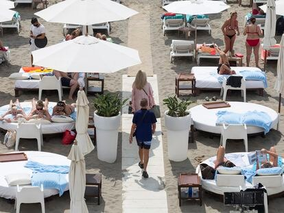 Tourists on a beach in Torremolinos (Costa del Sol) in July.