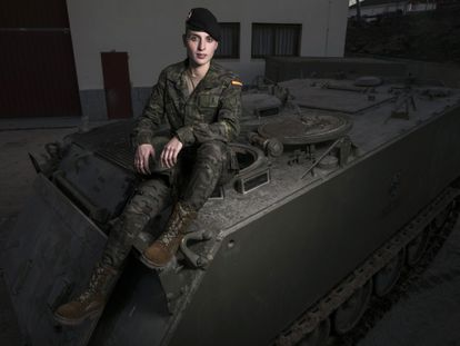Natalia Ortiz on an armored wheeled vehicle