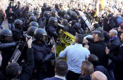 Police clash with protestors in Madrid today.