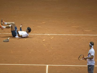 Rafael Nadal slips on court during his doubles match with partner David Nalbandian.