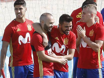 David Villa, Andres Iniesta, Asensio, and Reina.