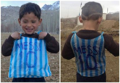 The child wearing a plastic Messi shirt.