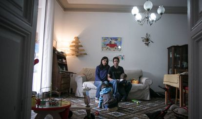 Mery and Gotzon with their two children in their home.
