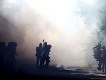 Clashes continued on Friday morning, including this road block near the  Sotón de Hunosa mine.
