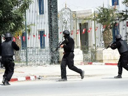 Tunisian security forces surround the area where the attacks took place.
