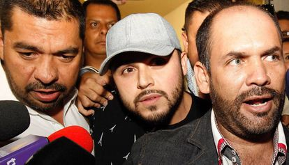 Singer Gerardo Ortiz (c) after making a statement.