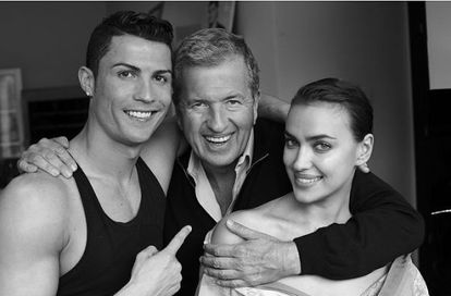 Fashion photographer Mario Testino between Cristiano Ronaldo and Irina Shayk.