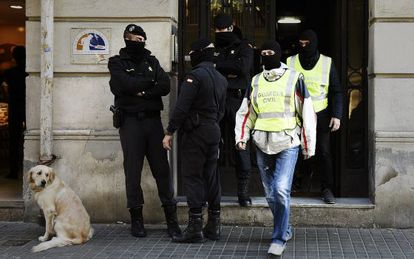 Police carry out a raid in Barcelona in October 2015.