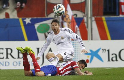 Sergio Ramos and José Sosa vie for the ball in the second leg match between Real Madrid and Atlético.