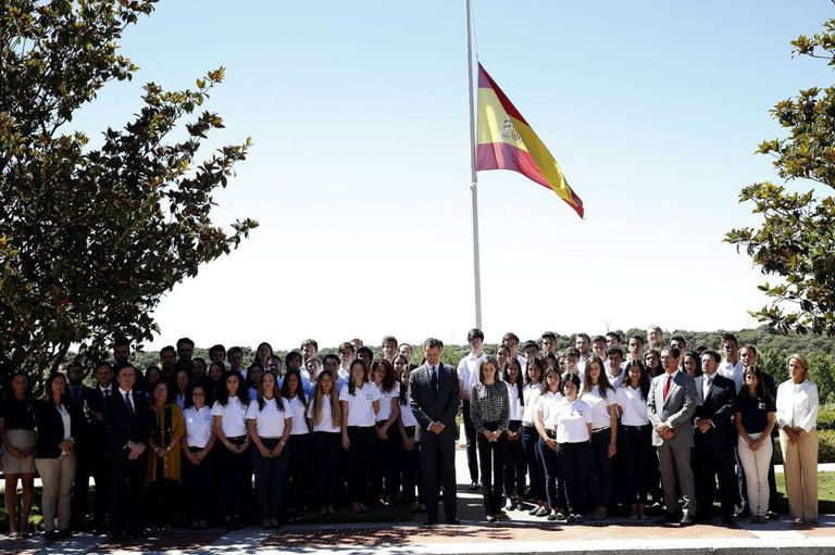 The Spanish royal family and a group of students observe a minute's silence after the Nice attack.