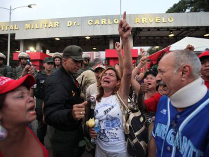 Supporters of Venezuela's President Hugo Chávez react to the news of his death.